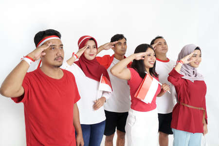 Foto per indonesian people on flag ceremony giving salute - Immagine Royalty Free