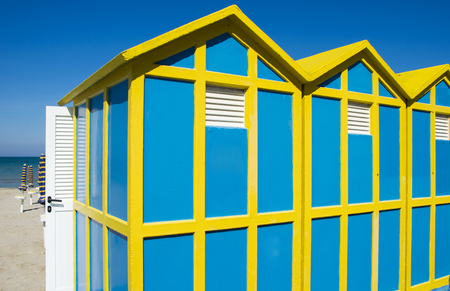 Beach cabins yellow and blue