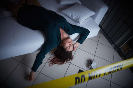Photo for crime scene - woman liyng dead on the sofa - Royalty Free Image