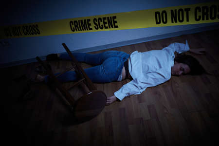 Photo for crime scene - woman lying dead on the floor - Royalty Free Image