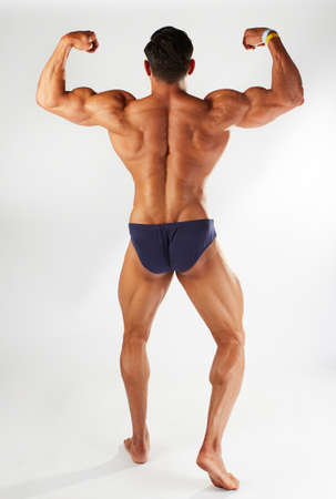 Photo for male body builder posing in studio background - Royalty Free Image