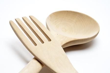 New wooden kitchen utensils on white background