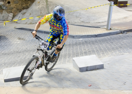 TOLEDO, SPAIN - SEPTEMBER 9: Unidentified competitor during the  I Toletvm Urban DH competition on September 9, 2012 in Toledo, Spain.  The tour had 860 meters away with 70 meters ramp. The  winner was Jose Miguel Qu?z