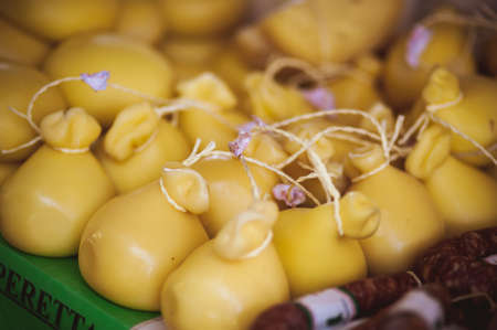 Foto de many forms of CACIOCAVALLO CHEESE sold at local market - Imagen libre de derechos