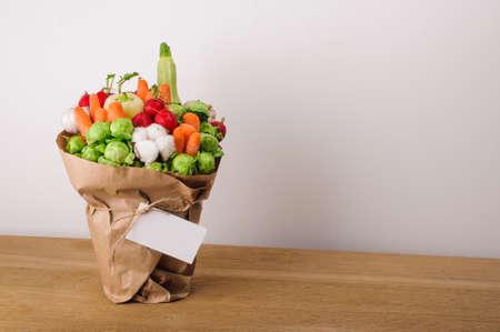 Foto für The original unusual edible bouquet of vegetables and fruits on  wood with card - Lizenzfreies Bild