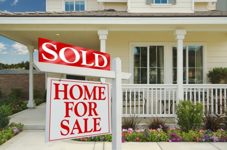 Sold Home For Sale Sign in front of Beautiful New Home.