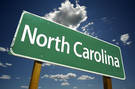 North Carolina Road Sign with dramatic clouds and sky.