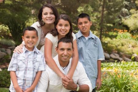 Happy Hispanic Family Portrait In the Park.
