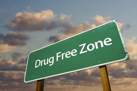 Drug Free Zone Green Road Sign Over Dramatic Clouds and Sky.