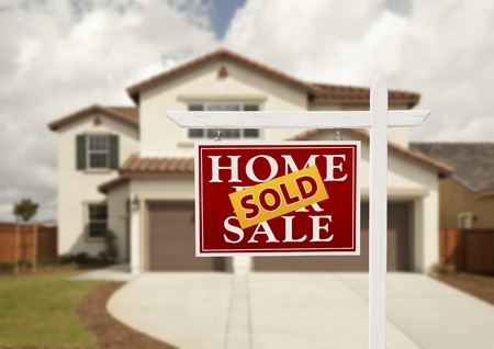 Sold Home For Sale Real Estate Sign in Front of New House.