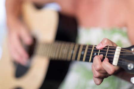 Photo pour Woman Playing Ccoustic Guitar Abstract.. - image libre de droit