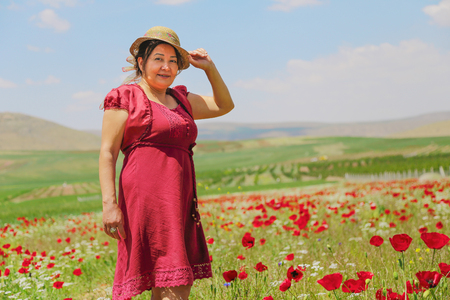 There is very natural place in Turkey. And happy old woman with wild flower.