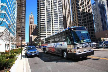 Chicago, Illinois - April 26, 2010: Chicago city street scene with tour bus.