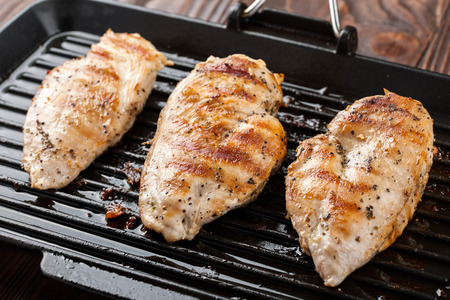 Grilled chicken breast fillet in the pan