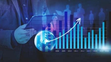 Foto de Businessman analysis financial graph,business graph background - Imagen libre de derechos
