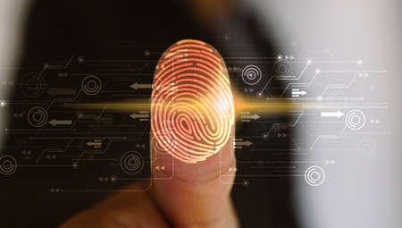 Photo pour Businessman login with fingerprint scanning technology. fingerprint to identify personal, security system concept                                     - image libre de droit