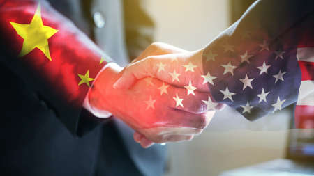 Photo for Businessman shake hand over United States of America and China flag. - Royalty Free Image
