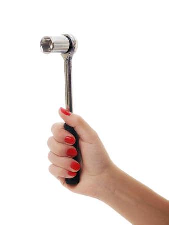 Photo pour woman hand working with spanner - image libre de droit