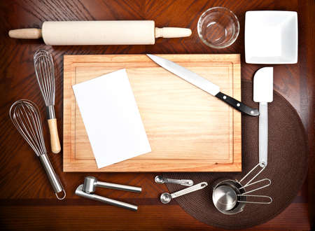 Cooking tools and untensils with a blank white card