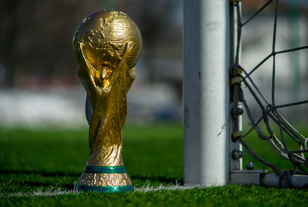 Photo pour April 9, 2018 Moscow, Russia Trophy of the FIFA World Cup on the green grass of the football field. - image libre de droit