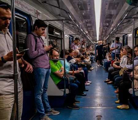 Photo pour May 30, 2019, Moscow, Russia. Passengers in the Moscow subway car. - image libre de droit