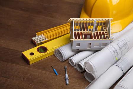 Foto de Construction plans with helmet and drawing tools on blueprints - Imagen libre de derechos