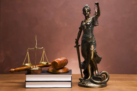 Gavel of justice and gavel on desk with dark background