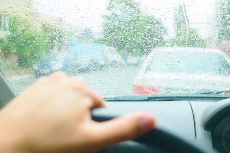 Photo pour Driving in rain. Raindrops on the windshield - image libre de droit
