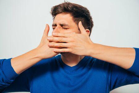 Photo pour man closes a mouth hands - image libre de droit