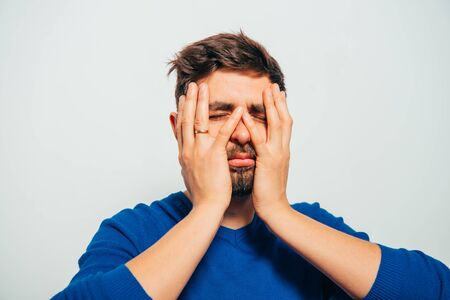 Photo for man covered his face with his hands - Royalty Free Image