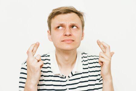 Photo pour man crosses his fingers. Good luck, hope - image libre de droit