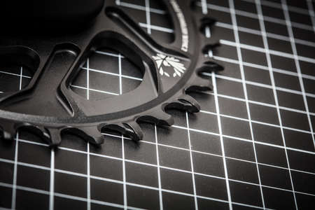 A bicycle front chainring ready to be installed onto a mountain bike