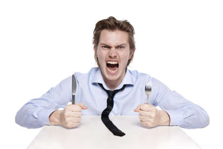 Young man is hungry. Studio shot of hungry man, isolated on white.