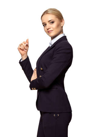 Photo for Studio portrait of a serious blonde business woman with raised hand. Isolated on white background. - Royalty Free Image