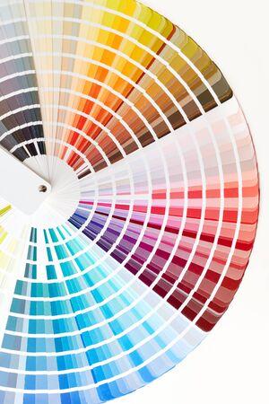 Foto de Close-up of color swatches book. Diverse colors paint samples catalog. - Imagen libre de derechos