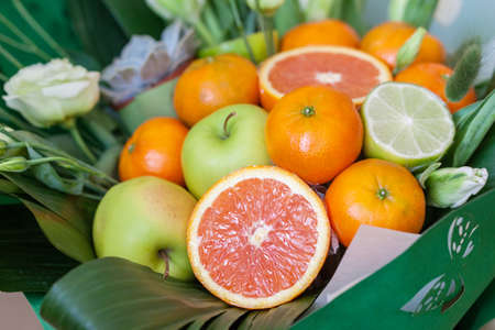 Photo for Bouquet of fresh fruits and flowers. close up - Royalty Free Image