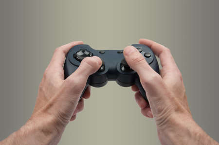 Hands holding video game controler as in a third person game
