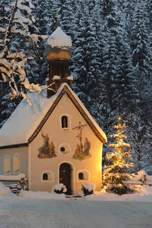 christmas chapel and illuminated tree at night
