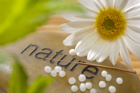 alternative medicine with homeopathy, globules and acupunkture