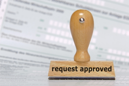 rubber stamp marked with request approved