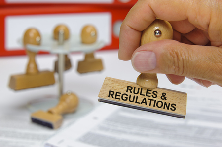 rules and regulations marked on rubber stamp