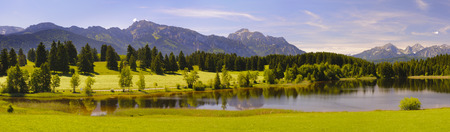 panorama landscape in Bavaria with lake and alps mountains at spring