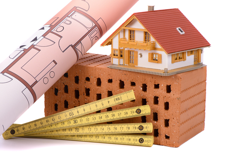 Photo for brick for house construction and tool with model house - Royalty Free Image