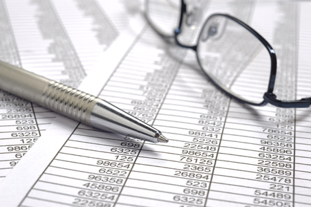 financial accounting with table sheet, pen and glasses