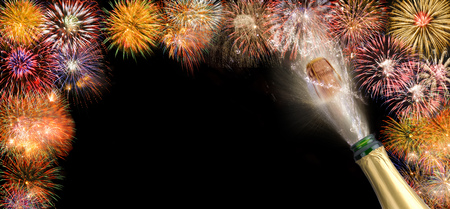 popping cork of champagne with fireworks for new year' s 2018