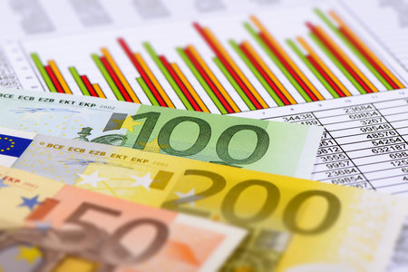 banknotes of European currency laying on chart of stock market