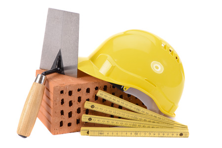 Foto de house construction with brick, tools,  plan and model house - Imagen libre de derechos