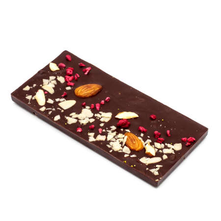 Photo pour Handmade white, milk and dark chocolate bar with a variety of dried fruit and nut toppings on a white background - image libre de droit