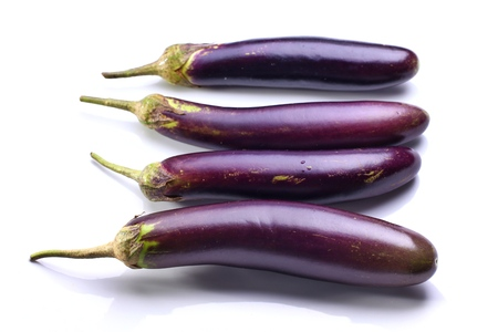 Photo pour Still life photography of eggplants on white background, shooting in advertising studio. Popular vegetables for cooking served with steamed rice, vegetarian and heathy food concept. - image libre de droit