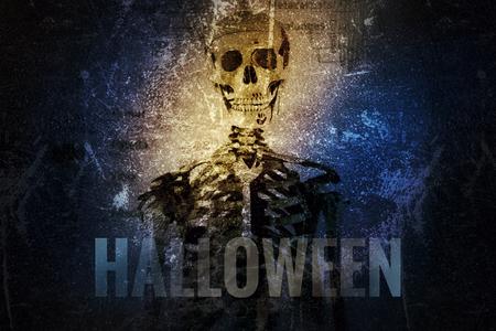 Multiple exposure, skull and  skeleton for Halloween background.